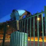 Jessica climbing over the fence